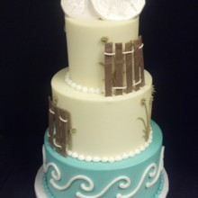 220x220 sq 1416251030925 beach cake   3 tier with blue base topped with san