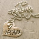 130x130 sq 1213581622340 holdheartnecklace