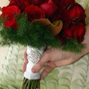 130x130_sq_1332889684707-redrose