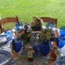 130x130 sq 1381113558214 trio of centerpiec es for dinig tables at tudor place