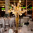 48x48 sq 1384735388701 golden reception centerpiece