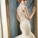 8214 <br /> Peach Organza and Ivory Tulle body skimming silhouette, strapless Ivory Alencon Lace bodice, chapel train. Ivory Alencon Lace shrug (sold separately). Shrug available in Ivory or White. Gown available in Peach/Ivory, Solid White/Solid Ivory.