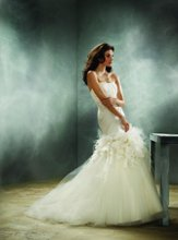 JH8159: Ivory Tulle full circular bridal gown, strapless Silk Satin Faced Organza elongated draped bodice accented with floral detail, chapel train. Available in White or Ivory.
