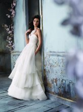 JH8100 Ivory Silk Organza bridal Ball gown, strapless draped bodice, sweetheart neckline, natural waist, irregular three tiered skirt, chapel train. Organza wrap top with pleated ruffle Organza neckline. Floral crystal chiffon neck piece with satin ribbon.
