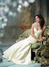 JH8106 Antique Silk Faced Satin strapless A-line bridal gown, sweetheart neckline, elongated draped bodice, circular skirt, chapel train. Tulle Shrug accented with embroidered crystal sleeves.