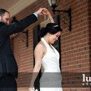 130x130_sq_1298870379742-brideshowingoffdress