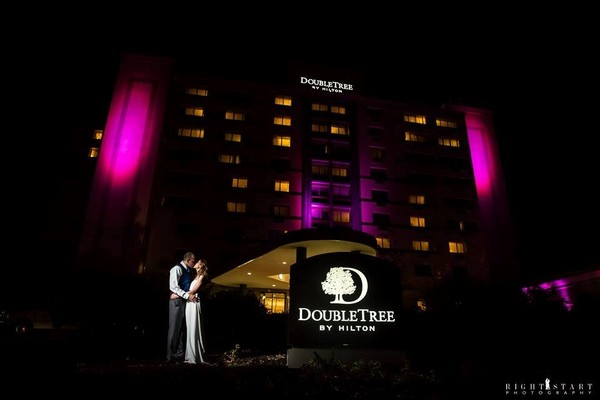 600x600 1443449808411 hotel picture in front of dt sign bride and groom
