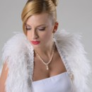 Bridal Ostrich Feather Wrap/ Shrug. Available in 2 colors $289.00 http://chicauraaccessories.com/collections/bridal-collection/luxurious-bridal-ostrich-feather-wraps-with-affluent-trim-of-veins-lace-and-austrian-swarovski-crystals.html