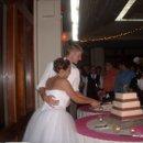130x130 sq 1288198858765 cakecutting