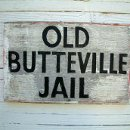 130x130 sq 1345848824621 jailsign