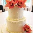 130x130_sq_1332532688380-2tierbuttercreamweddingcakeorangeorchids2
