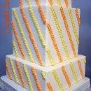 130x130 sq 1332532703652 orangeyellowsquaresequinedstripeweddingcake