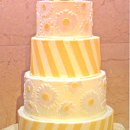 130x130_sq_1351892789978-yellowdiagonalstripedaisybuttercreamweddingcake