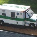130x130 sq 1318541605496 ambulancecake