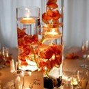 130x130 sq 1474037567165 submerged orange orchids in cylinders