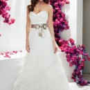 1751  <br /> Mikaella Satin and Organza bridal gown. Strapless crossover draped bodice with ribbon and broach embellishment at natural waist. Organza ruffled skirt with couture hem. Chapel Train.