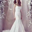Style 1805   Mikaella Lace Bridal Gown. Pleated tunic lace bodice with lace flared gathered skirt. Sweep Train.