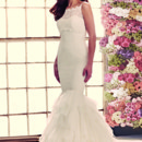 Style 1902  Mikaella Lace and Tulle Wedding Dress. Strapless tunic bodice with scoop neckline. Layered full tulle skirt. Invisible zipper. Removable bolero with boat neckline. Back closure with covered buttons and loops. Sweep Train. Available colours: Natural.