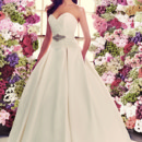 Style 1916  Mikaella Satin and Mikaella Re-embroidered Lace Wedding Dress. Strapless lace sweetheart neckline with dropped waist bodice. Removable sash with beaded embellishment at natural waist. Double box pleated satin skirt with side pockets. Cathedral Train. Available colours: Diamond.