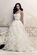4363  French Alençon Lace and Organdy wedding dress. Strapless sweetheart lace bodice with ribbon and broach at natural waist. Ruffled organdy skirt. Sweep Train.