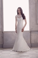 4404  French Alençon Lace and Silk Dupioni Wedding Gown. Sleeveless lace bodice with bateau illusion neckline and deep low back. Removable Dupioni sash with back flower bow and detachable train. Fit and flare skirt with hem lace.