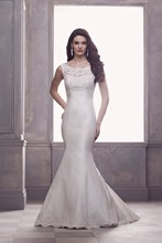 4410  French Alençon Lace and Silk Dupioni Wedding Gown. Beaded lace bateau illusion sweetheart neckline with sleeveless covered back. Dupioni princess fit and flare skirt. Covered buttons over zipper to hem. Sweep Train.
