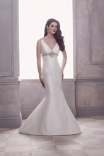 4414  Silk Dupioni Crossover V-neckline Wedding Gown. Empire bodice with beading on shoulder straps and empire. Fit and flare skirt. Covered buttons over zipper to hem. Sweep Train.