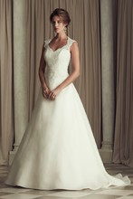 4452  Paloma Re-embrioidered Lace and Organdy bridal gown. Beaded lace bodice with low keyhole back with sweetheart front neckline. A-line organdy skirt. Chapel Train.