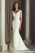 4460 Paloma Re-embroidered Lace and Silk Dupioni bridal gown. V-neck beaded lace bodice with cap sleeves. Lace cascading onto skirt. Fit and flare Dupioni skirt with removable ribbon and flower detail at natural waist. Covered buttons over zipper to hem. Sweep Train.