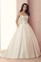 4511  Silk Dupioni Wedding Dress. Strapless drop waist bodice with all over beading. Double box pleated full skirt with side pockets. Cathedral Train.