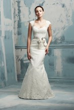 Style 4105   Chantilly Lace wedding dress. All lace dress with keyhole back detail. Ribbon and broach embellishment at waist. Fit and flare skirt with couture hem. Sweep Train.