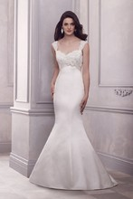 Style 4406   French Alençon Lace and Silk Duchesse Bridal Gown. Beaded lace sweetheart empire neckline bodice with lace straps. Ribbon with flower detail at empire. Princess fit and flare skirt. Chapel train.