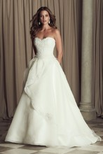 4463 French Alençon Lace and Organdy bridal gown.Strapless sweetheart drop waist lace bodice. Full organdy skirt with cascading mohair detailed edging with lace appliqués scattered. Chapel Train.