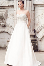 Style: 4552 Silk Dupioni Wedding Dress. Beaded bodice with sweetheart neckline. Dupioni spaghetti straps. Removable Dupioni sash at waist. A-line Dupioni skirt with pleated back. Invisible zipper. Cathedral Train. -