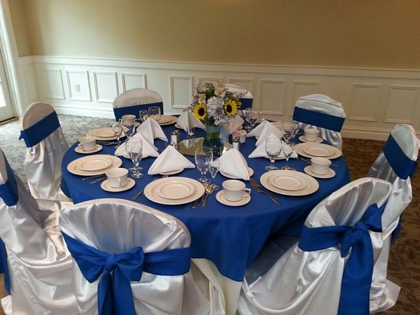 600x600 1417900238158 blue and sunflower wedding table