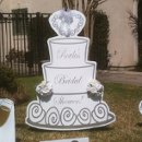 Giant Custom Bridal Cake personalized with bride & groom names. White decorative sign with many lettering colors available.