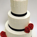 130x130 sq 1402782996554 wedding cake icicle rolled roses red base ribbon 2