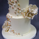 130x130 sq 1402783249274 wedding cake sixlets white flower gold silver pink