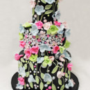 130x130 sq 1470855771728 3tot black  multicolor fondant cascading flowers