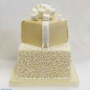 130x130 sq 1470857601085 2tot ivory  white fondant bow  scrolls square wedd