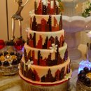 130x130_sq_1258574756409-weddingcake28