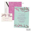 Cherry blossom time is wedding time, and this beautiful Jean M wedding invitation will get guests in the spirit for both! The two-sided wedding invitation features the pink blossoms on an aqua background surrounding your wording on the front. The back is a pink pattern.