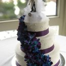 130x130 sq 1310418077020 weddingcakeblueorchids