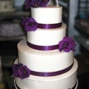 130x130 sq 1310418425335 weddingcakepurpleribbonpurpleflowers