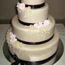 130x130 sq 1310420712014 weddingcakeivoryfondantwithsalmonpinkrosesandblackribbon