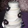 96x96 sq 1310418172431 weddingcakefondantgatheringpurpleflowers