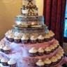 96x96 sq 1310418557513 weddingcaketieredcakewithcupcakes