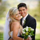 130x130_sq_1384531343429-istock-photo---bride--groom-with-bouquet-of-flower