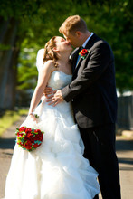 220x220 1415917088251 photo   jazz unlimited band   bride  groom kissing