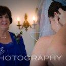 130x130_sq_1294262487172-weddingwire67